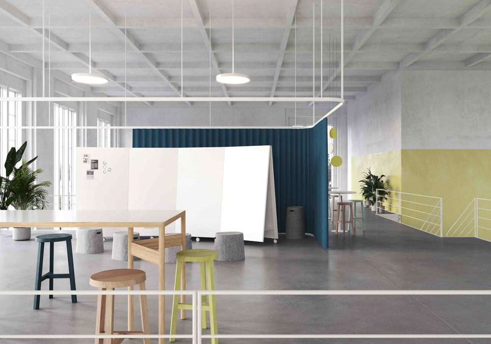 agile office furniture by moving walls set up in a open space or networking zone